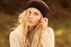 curly blonde in a hat