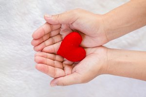 Red heart shaped in hand