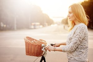 blonde woman on a vintage bicycle