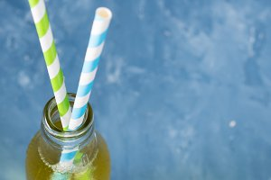 Lemon soft drink with straws