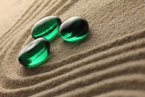 green stones on a sand