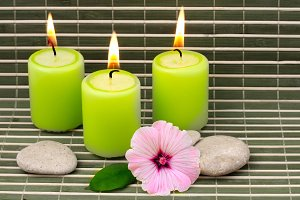 candles, stones and flower
