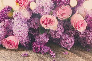 Lilac flowers and roses