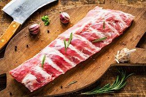 Pork ribs on wooden cutting board