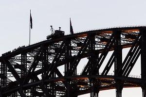People climbing over Sydney bridge