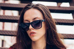 Beautiful girl in sunglasses.
