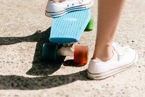 Beautiful hot girl with skateboard.