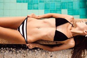 Beautiful girl have fun in the pool.