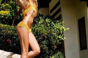 Young sporty girl in knitted bikini.