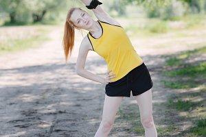 Runner stretching body before run