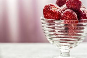 Sugared strawberries in a glass cup