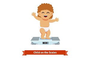 Happy baby toddler on scales