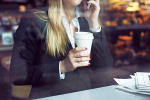 Business woman on coffee shop