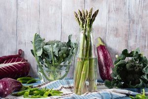 Raw vegetable on wooden background