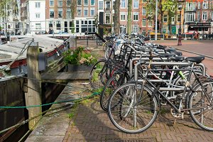 bicycles next to canal of Amsterdam