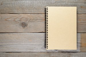 Closed notepad on wooden table