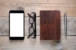 Smartphone, glasses, diary and pen