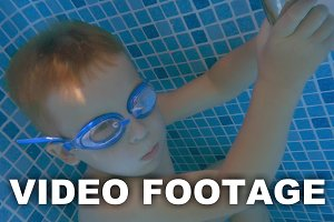 Boy in Goggles Holding Breath