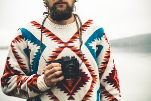 Man bearded with retro photo camera