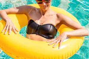 Pretty girl with inflatable ring.