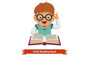 Boy in glasses reading book