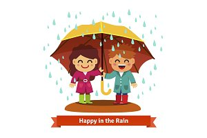 Boy and girl standing under umbrella
