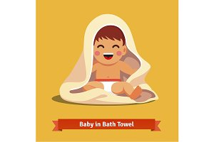 Boy toddler wrapped in bath towel