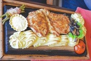 Grilled pork on dish