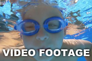 Boy in Goggles Under Water