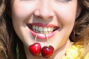 Happy woman with cherry