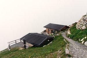 View on house roofs on the edge of a mountain in Austria