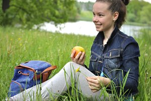 Girl with apple on a picnic