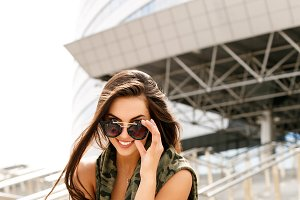 Beautiful girl in sunglasses smile.