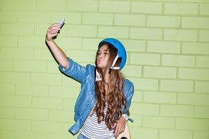 Beautiful cute girl with smartphone.