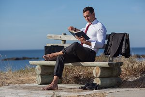 Businessman reading outdoors