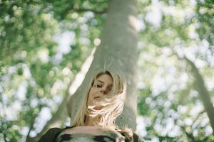 blonde woman in the forest