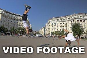 Two guys doing acrobatic tricks