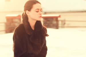 sensual girl in a fur coat