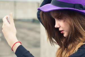 girl in purple hat