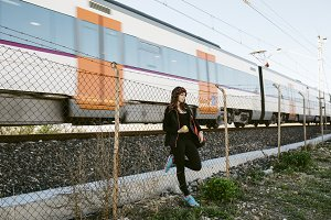 Woman near of a railway