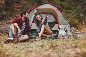Young couple on a camping holiday