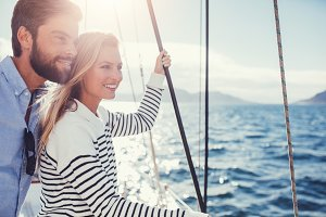 Happy young couple on sail boat