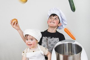 Two children cooking with a futuristic machine