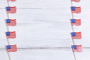 Rows of USA Flags on white wood