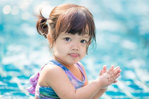 little girl swimming in outdoor pool
