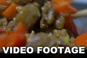 Vegetable stew stirring