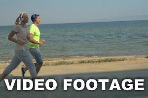 People in Headphones Jogging