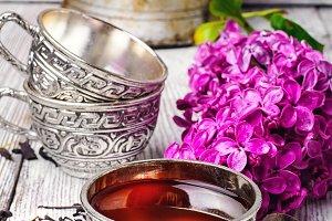 Stylish metal cup of tea