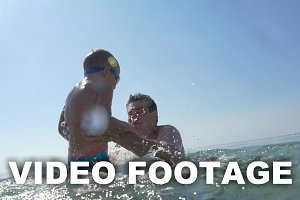 Father and son having fun in sea