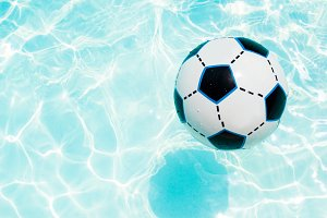 Beach ball in the swimming pool